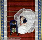 bride and groom seated on liverpool town hall stairs. Photographed  from above by liverpool wedding  photographer daniel charles photography