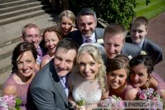 bridal party looking up at camera