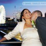 groom kissing bride's neck on balcony of hard days night hotel liverpool