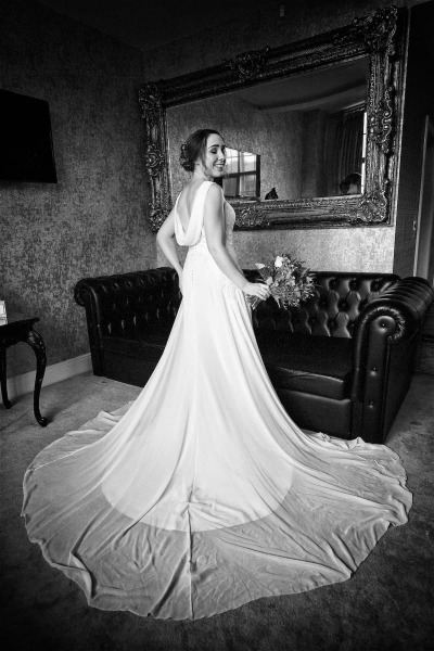a black and white  full length bridal portrait