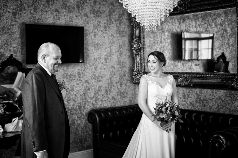 A bride smiles at her stand-in dad