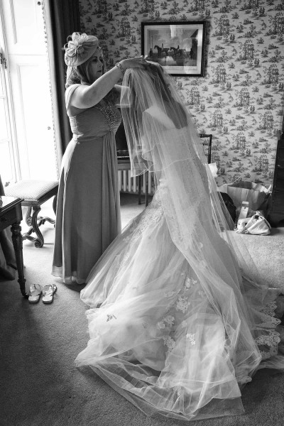 bride's veil being pinned in place