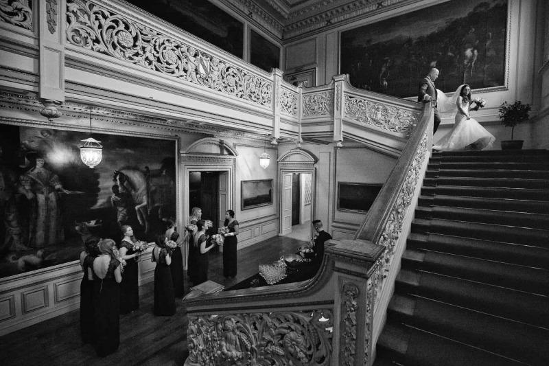 Bride and her father descending main staircase of Knowsley Hall