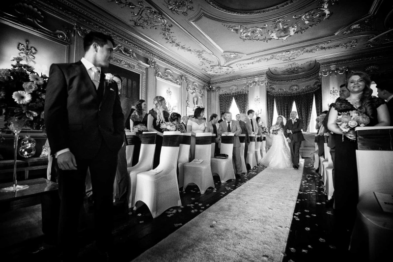 groom turns to see his bride approach