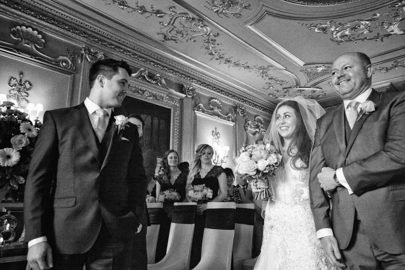 bride arrives at grooms side in ballroom of knowsley hall