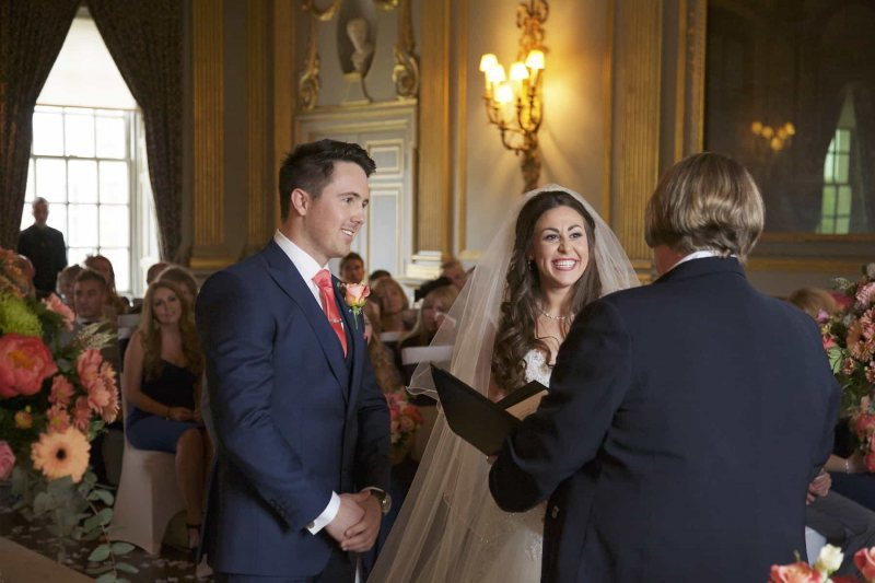bride and groom being addressed by registrar at Knowsley Hall wedding