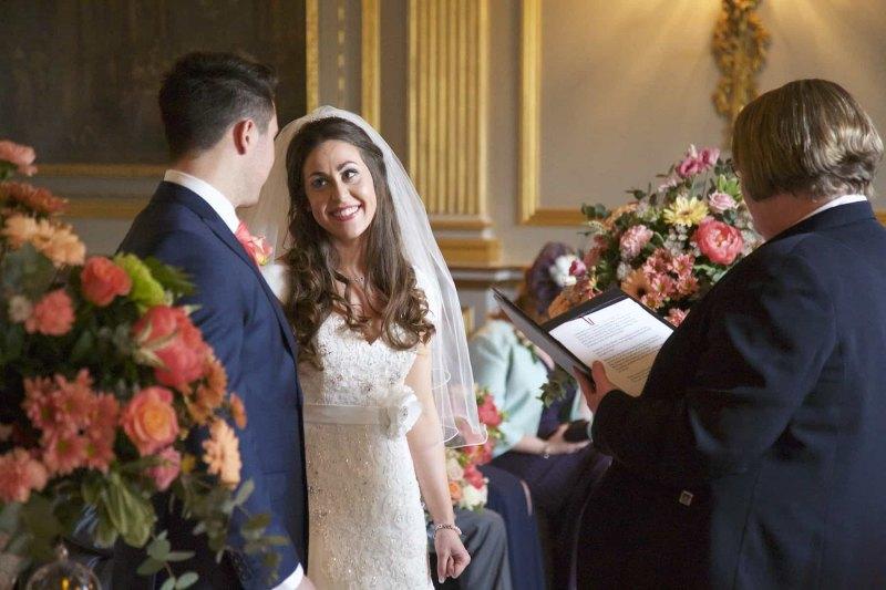 bride looks at groom in wedding ceremony