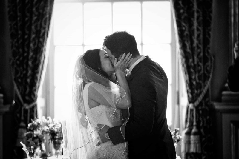 black and white photo of first kiss