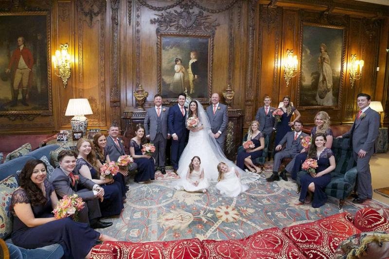 bridal party arranged in Walnut Drawing Room, Knowsley Hall