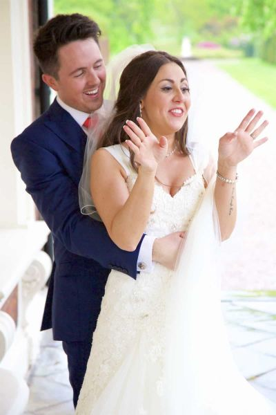 bride gasps after groom whispers in her ear