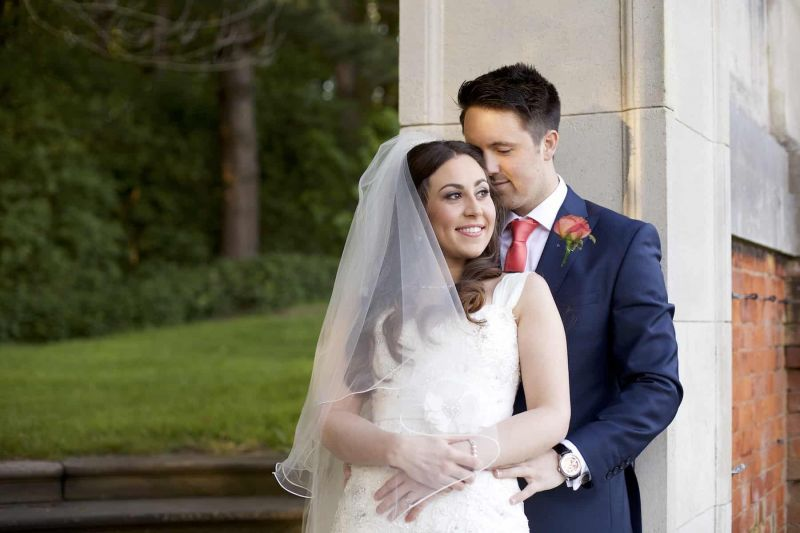 bride and groom embracing in gardens of knowsley hall