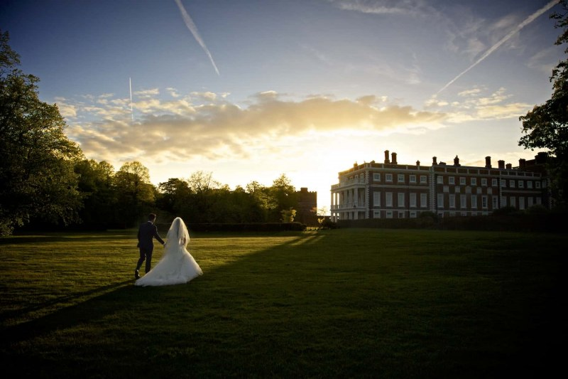 bride and groom walking in gardens of knowsley hall