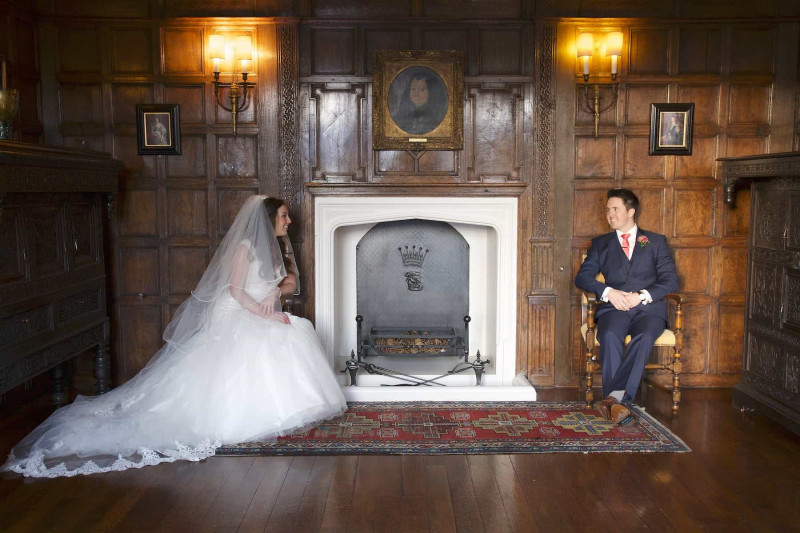 bride and groom seated in jacobean room in knowsley hall
