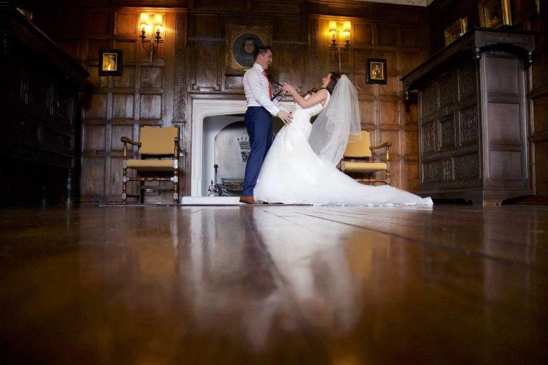 bride pulling grooms braces in knowsley hall jacobean room