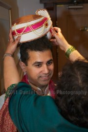 Aash's parents helping with his preparations.