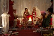 The fathers in law take part in the fire ceremony