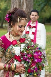 Anita's stunning floral bouquet complemented her sari magnificently