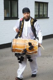The groom's procession is accompanied by fantastic dhol players