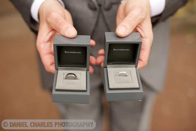wedding rings in boxes taken by cheshire wedding photographer daniel charles photography