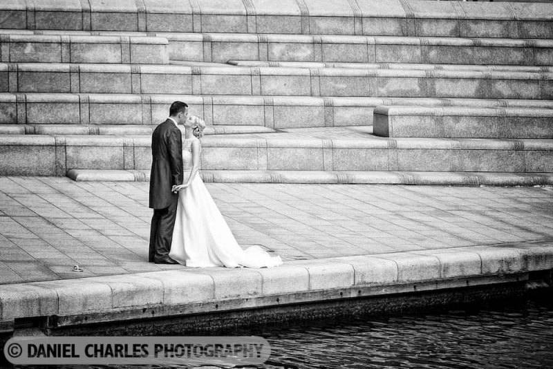 bride and groom by water