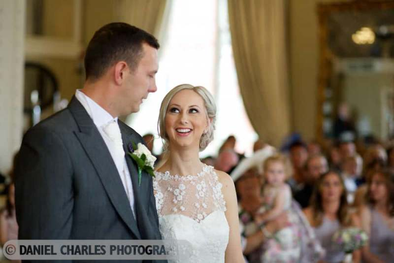 bride smiles at groom at start of ceremony