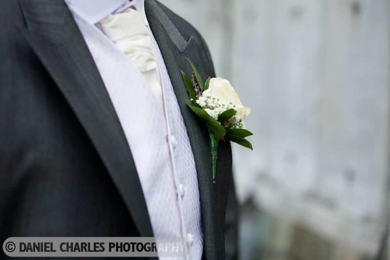 close up detail of grooms buttonhole flowers