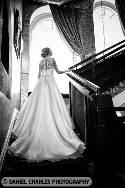 bride ascending stairs black and white