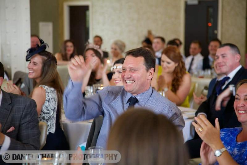 guest laughing at groom's speech