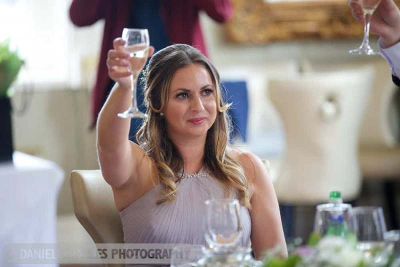wedding photography 30 james street bridesmaid raising glass
