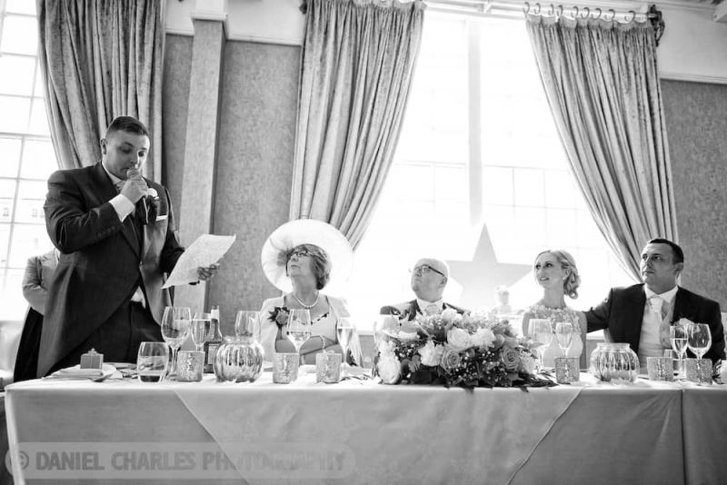 black and white image head table during best man's speech by daniel charles photography liverpool wedding photographer