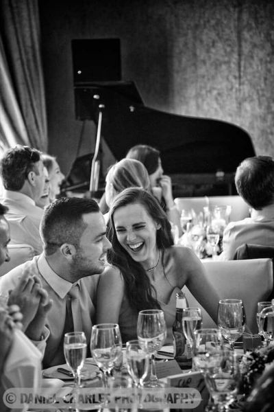 black and white image of guests laughing white star room 30 james street wedding photography