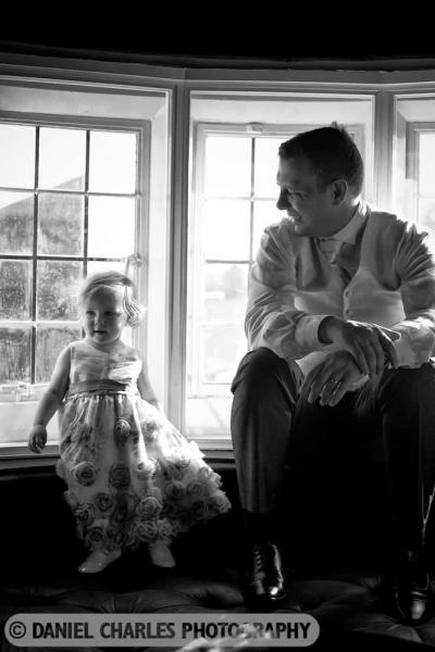 groom looking  at daughter