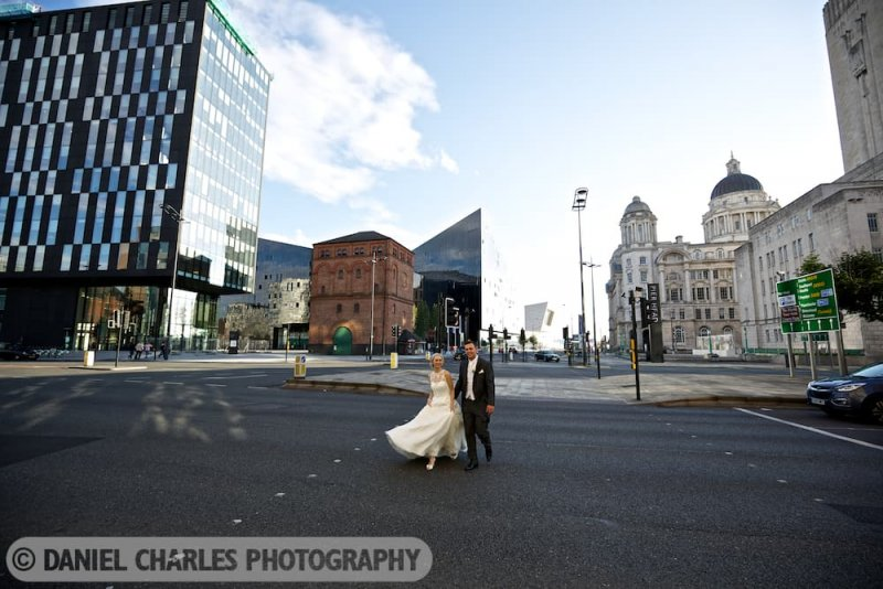 bride and groom crossing road by 30 james street wedding photography