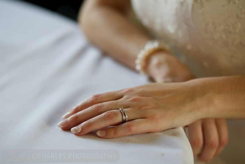bride\'s hand on wedding dress showing the ring