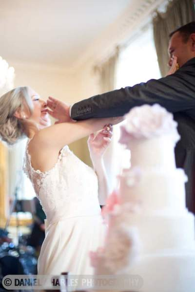 bride and groom fighting over cake