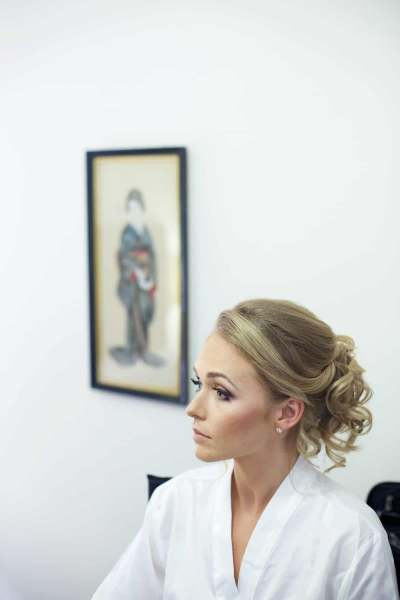 a bride waiting for the makeup artist