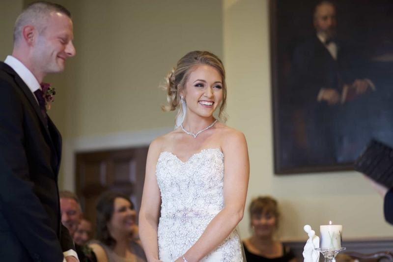 a bride is laughing with the registrar