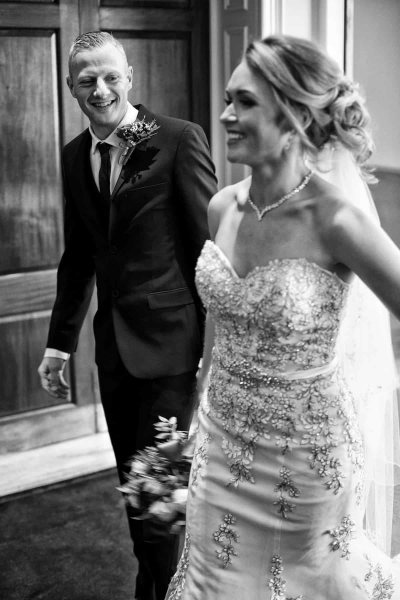 bride and groom leaving their wedding ceremony together