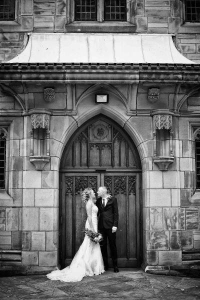 a bride and groom looking at each other outside the church