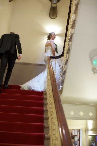 bride and groom ascending the racquet club stairs