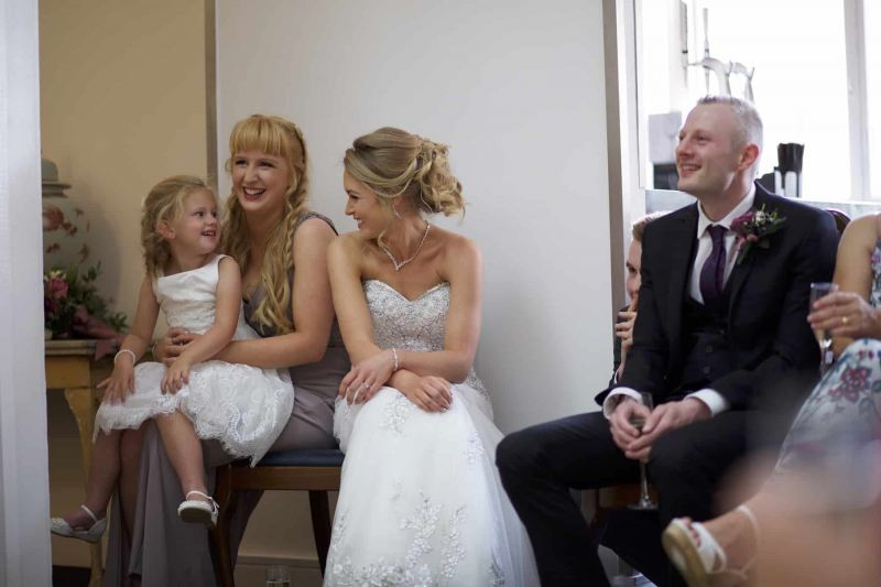bride and bridesmaids laughing at speeches