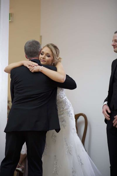 bride embraces  her father after his speech