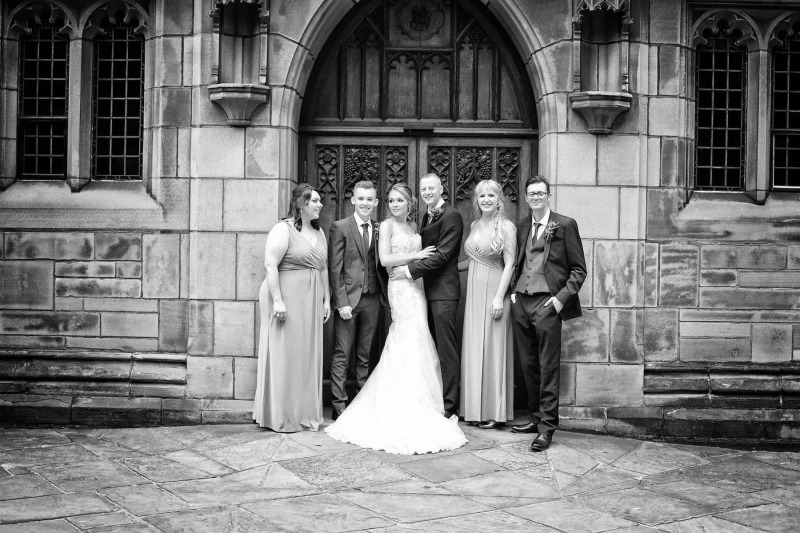 bridal party standing outside church door in liverpool