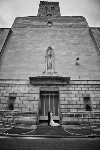 bride and groom standing by ventilation  tower of birkenhead tunnel