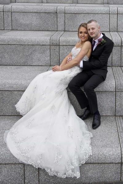 bride and groom seated on mann island steps