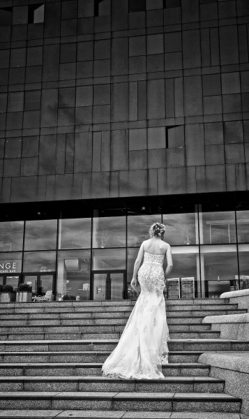 bride ascends steps of Mann Island Dock in Liverpool wedding photo