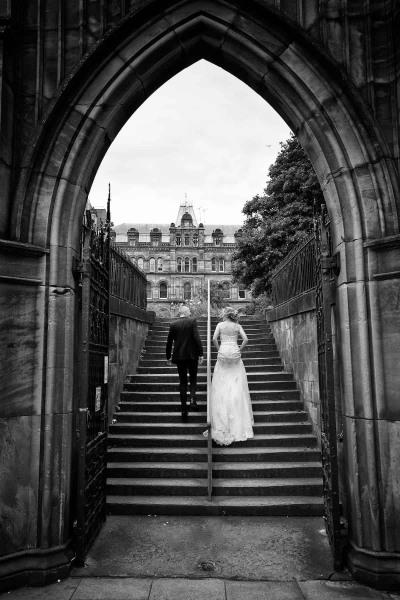 Bride and groom ascending steps into St Nicholas Gardens, Liverpool