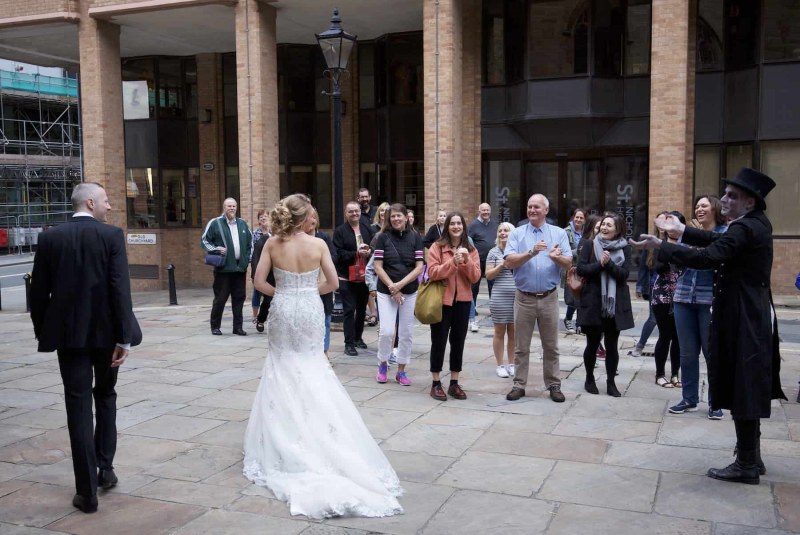 bride and groom being applauded by tourists in liverpool