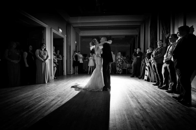bride and groom perform their first dance