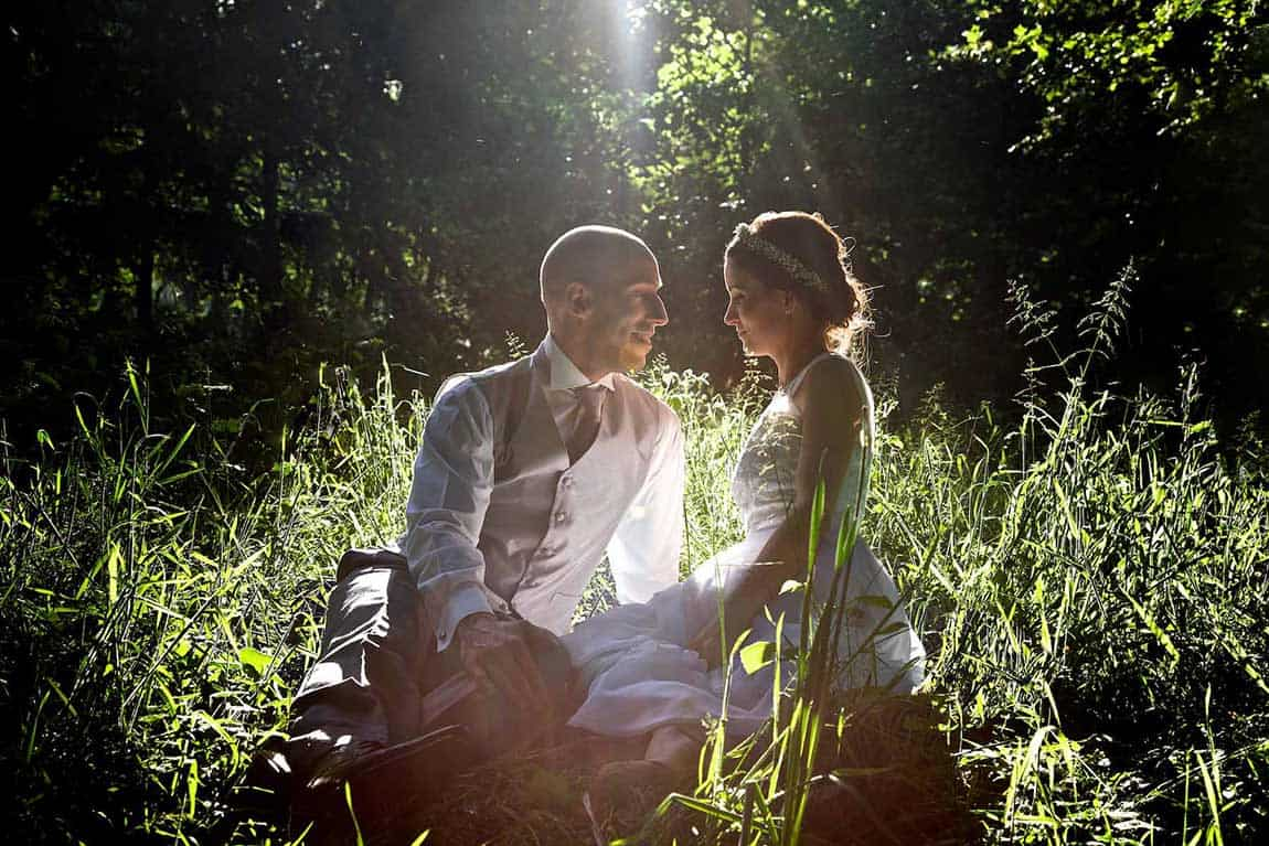 bride and groom seated in woodland